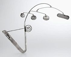 This Brooch/Barrette by Alexander Calder was acquired by John and Ruth Boland at the Paris Exhibition in Washington, DC  in 1944. In addition to the mobiles that made him famous, Calder also created 1800 pieces of jewellery. He started making jewellery at age 10 for his sister's dolls, using wire he found in the streets. By the late 1930s and '40s, he was creating jewellery sculptures, among them were combs and tiaras | Sotheby's sold for $192,000 in 2006