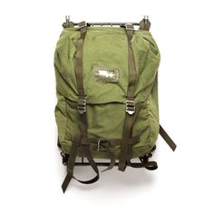 This Swedish LK35 Military Backpack holds 35 liters' worth of supplies. Adjustable padded shoulder straps anchor a lightweight frame over a tailored base ideal for hiking and other short-distance trips. Rubberized top flap with drawstring closure helps keep out moisture. Inner pocket with elasticized top runs the length and height of bag. Adjustable straps with metal buckles. Seen at Best Made Company