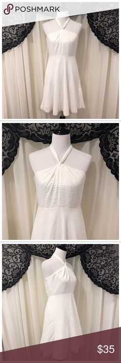 J. Crew Embossed Cotton Halter Dress SZ 10 Dress is by J. Crew and is a size 10 It's a white halter dress with embossed, textured, cotton fabric Has stay up silicone lining inside the bust, light boning at the sides, and a concealed zipper closure at the side Dress is in great preloved condition with no holes rips or stains  Tassels are attached at the top of the bust  100% Cotton Approximate measurements: (38in bust- 28in waist- 31in length)  Thanks for checking out my listing! Not…