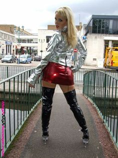 Blonde amateur in metallic silver leather jacket, shiny red latex miniskirt and thigh boots Silver Leather Jacket, Leather Pants, Skirts With Boots, Mini Skirts, Skirt Boots, Micro Skirt, Latex Girls, Sexy Latex, Satin Blouses