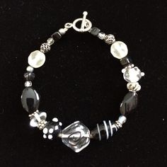 Black White and Silver Breaded Bracelet Bracelet with black, white, clear and silver funky beads. Toggle clasp. Like new. Smoke free home. Jewelry Bracelets