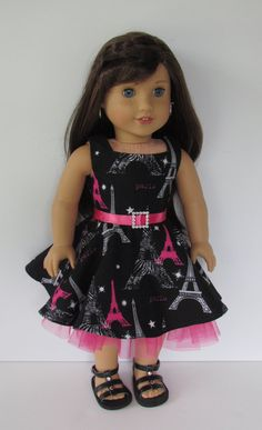 Eiffel Tower print dress with petticoat and hot pink ribbon belt. Made with the Geometry Class Dress and Jumper pattern, found here http://www.pixiefaire.com/products/geometry-class-dress-jumper-18-doll-clothes.  #pixiefaire #geometryclassdressandjumper