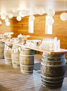 vintage wine barrels unique table which fits in with the rustic themed weddings
