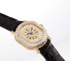 DANIEL ROTH. AN IMPRESSIVE AND RARE LADY'S 18K GOLD AND DIAMOND-SET TONNEAU-SHAPED AUTOMATIC WRISTWATCH
