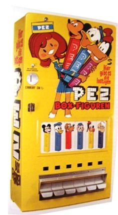 Yellow Euro PEZ girl machine - Pez decided they needed a fun way to sell their Pez, and this vending machine had a girl teller to make it look more attractive!