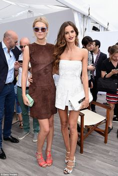 Amazing: Toni caught up with fellow model Izabel Goulart who wore a cute white embellished mini dress and statement heels