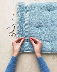 DIY cushion for dog crate-Great idea! Much cheaper than a crate pad purchased at a pet store, and much more suited for laundering. Could use new or older towels. I'll be doing this!