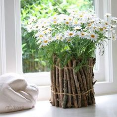 Make the prettiest pots using twigs and upcycled containers. Beautiful for wedding centerpieces, gifting flowers in or keeping for yourself!