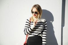 A slimming black and white striped sweater that fits like a glove without compromising comfort. Black And White Tops, Black White Stripes, Striped Top Outfit, Stripes Fashion, Sweater Outfits, Spring Summer Fashion, Street Style, Sweaters, Emily Schuman