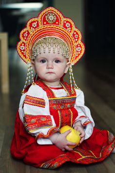 A toddler dressed in Russian traditional costume.  #folk #fashion #headdress