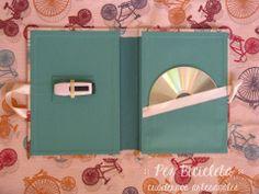 :: Pez Bicicleta Cuadernos Artesanales:: https://www.facebook.com/PezBicicletaCuadernosArtesanales  Contenedores para CD y DVD. Forrados en tela de encuadernación o estampadas, tapas duras, con sobre interno para guardar CD / DVD. Con cintitas para cerrar con un moño (también puede ser elástico). Ventanita en tapa y/o contratapa para rotular.