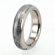 Meteorite Ring inlaid in Wavy Platinum / Solid by jewelrybyjohan, $1899.00 - like the idea, but without the meteor.