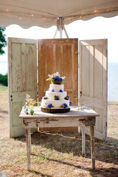 Rustic backdrop with old doors....Not this but my mom has this wood and lace thing upstairs I would LOVE to use.