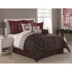 This exquisite comforter set in taupe, chocolate and burgundy features several shams and decorative pillows for the perfect touch. Crafted of 100 percent polyester, this comforter set is conveniently machine washable.