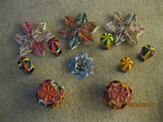 """Snowflakes, """"map"""" compound flower, """"diamond"""" cubes and small hot air balloons."""