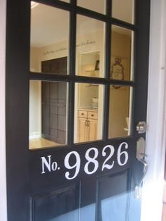 Painted house numbers. this is what i should do for our front door. but maybe frost the glass or add a shade.