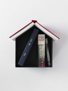 Birdhouse Bookshelf- A simple but highly functional, wall mounted bedside table that cleverly keeps the place in your book on its roof while creating a pretty book-roofed house (if you're terribly modern you can keep your Kindle or iPad on the roof instead). Apartment-dwellers will love it because it doesn't take up any valuable square-footage.