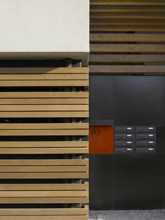 wood screen & red of sign ;-) __park associati - residential bldg