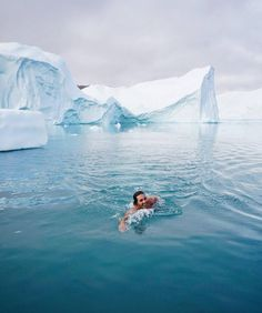 """5,016 gilla-markeringar, 122 kommentarer - WORLD'S LARGEST TRAVEL SOCIETY (@timeoutsociety) på Instagram: """"Just a casual morning swim in Greenland. Not a bad way to start the day 🤘. @auroraarktika . .…"""""""