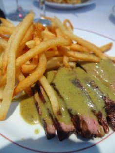 Entrecote Steak & Frites with their signature secret sauce -entrecôte is the French word for 'rib-eye'