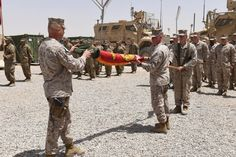 Members of Task Force Southwest prepare to raise the Marine Corps flag at a transfer of authority ceremony at Camp Shorab, Afghanistan, Saturday April 29, 2017. The Marines are taking over the Helmand train-and-advise mission from Task Force Forge, an Army unit (pictured in the background) which has been in Helmand since last year. (E.B. BOYD/STARS AND STRIPES)