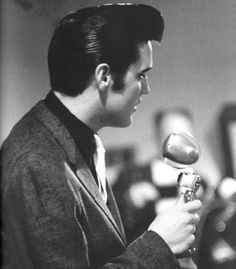 Elvis Presley during a press conference at the Pan Pacific Auditorium in Los Angeles, CA, on October 28, 1957.
