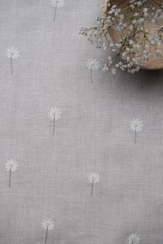 Beautiful hand embroidered Daisies by Peony and Sage, perfect for curtains, cushions and soft furnishings.