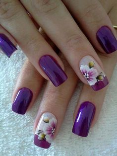 Dreamy violet inspired French manicure. use matte violet as the nails base color and plain white for the French tip. Line the tip with a medium size violet polish and top it off with a coating of a white hibiscus. It's a French tip you wont regret in having.