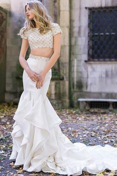Gorgeous two piece form fitting floor length satin skirt wedding dress with train and ruffles features fully beaded short sleeve high neck crop top with open back. Mermaid Prom Dresses, Bridal Dresses, Mermaid Skirt, Bridesmaid Dresses, Designer Wedding Dresses, Wedding Gowns, Wedding Pics, Wedding Bride, Wedding Stuff
