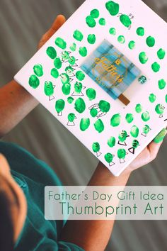 A fun way to share a Father's Day Starbucks Card. Using a square canvas, finger paint, and a little imagination—creating an artistic gift is as much fun to make as it is to give. Use fingerprints to create shapes on the canvas. Let dry. Then, with a black fine tip marker, transform those little fingerprints into anything from fish to farm animals. (For an added surprise we recommend hiding a photo of Dad's favorite artist behind the gift card too).