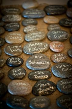 "rock place cards ""make a wish and throw it in the river"""