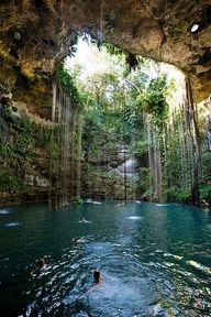 Xcaret Park, Mexico.  We swam this underground river.  It was absolutely amazing and looks just like this picture.