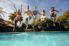 Group of crazy young people jumping into a swimming pool. Friends having fun at a holiday resort. Michael Phelps, Barcelona, Health Savings Account, People Having Fun, Photo Grouping, Holiday Resort, Model Release, Young People, More Photos