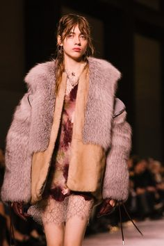 Fur jacket and lacy dress at Christopher Kane AW16