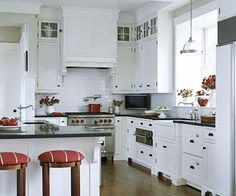 white cabinets with red accents...like red bar stools as pop of color. And like more modern feel with white backsplash...rd stove would look great