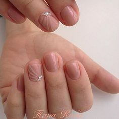 Elegant looking nude winter nail art. The design is very simple yet at the same time clean looking and pleasant. The frosted nail polish on top in diagonal stripes across the nails in the same color looks amazing and perfect with white beads added on top of the design.