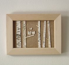 I wonder if I could get some flat bark and a nice wooden frame and make one of these for myself? So cute. So simple-looking. <3