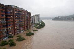 Residential buildings are seen partially submerged by an overflowing river after heavy rainfall hit Dazhou in Sichuan province, China.