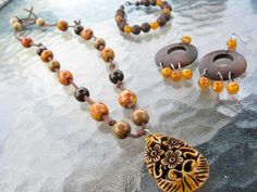 Dark Brown Wooded Bead Jewelry Set with Orange Accent  $35.00
