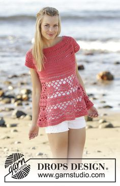 Crochet top with round yoke, lace pattern, worked top down in DROPS Paris. Size: S - XXXL. Free pattern by DROPS Design.