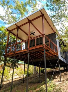 Baahouse is Australia's award wining small house experts. We design custom houses for your site, lifestyle and budget. House On Stilts, Tiny House Cabin, Tiny House Design, Modern Tropical House, Tropical Houses, Pole House, Hillside House, Shed Homes, River House