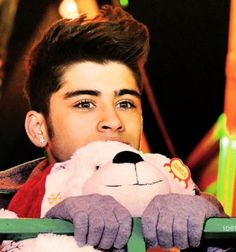 Day 14: Favorite photo of Zayn. this one is soooo cute. it shows that zayn can be serious and cute and hot and funny at the same time and it is AMAZAYN