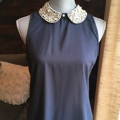 Sheer Navy Blue Blouse with Beaded Collar Beautiful navy blue blouse with beaded color. Material is sheer and would likely require a tank top underneath (or solid bra) depending on the look you're going for. There is an area where beading is coming loose (see photo) but could easily be fixed by someone who knows what they are doing. Collar is secured at back of neck with hook. Dizzylizzy Tops Blouses
