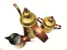 Vintage Copper Coffee Creamer Sugar Set, Made in Belgium has a classic and mid century profile with curved handles and spout and a lovely patina. In excellent condition.
