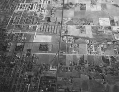 In 1949, this is what Colorado Boulevard in Denver looked like from the air where I-25 now crosses it. Colorado is that black line through the middle, the diagonal roadway is Buchtel Boulevard, with the Colorado & Southern Railroad parallel to it. The collection of white buildings are old army barracks from World War Two, housing students from DU.