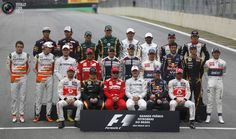 Formula One drivers pose for a group photo before the Brazilian F1 Grand Prix at Interlagos circuit in Sao Paulo