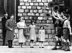 1932: Future King and Queen, George, Duke of York and Elizabeth, Duchess of York with their daughters, Princesses Elizabeth and Margaret Rose (1930 - 2002) of York watching a parade of Boy Scouts at Windsor Castle, Berkshire