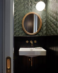 Black & brass against a green luxe wallpaper make this cloakroom, designed by a standout. Featuring London crosshead taps & bottle trap all in Tarnished Brass. Downstairs Cloakroom, Downstairs Toilet, Cloakroom Wallpaper, Modern Toilet, Luxury Wallpaper, Green Wallpaper, Bathroom Renovations, Bathroom Ideas, Bathroom Green
