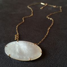 Made from an antique mother-of-pearl gaming chip from the 1600's with recycled 14k Gold & Sterling Silver. So in <3 with this special piece! Perfect for that one-of-a-kind Mother's Day gifts!