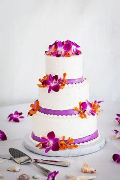 Gorgeous purple and orange beach wedding cake.
